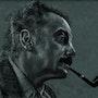 Georges Brassens de profil avec sa pipe. Philippe Flohic