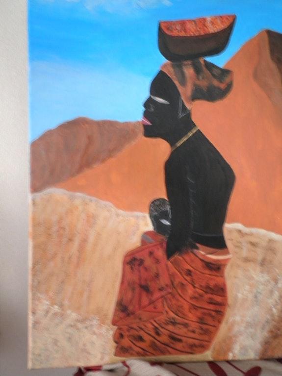 Femme africaine portant un enfant.  C. M.