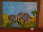 Maman elephant et son petit se désaltérant.