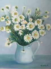 Die Vase mit Gänseblümchen.
