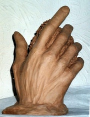 Rodin die Hand nach.