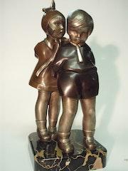Secrets d'enfance bronze patine signé kelety.