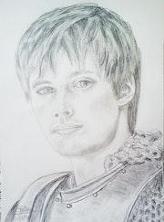 Bradley James acteur anglais dans le rôle Arthur série actuelle Merlin.