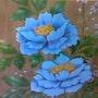 Pintua en madera, una flor. M. Pilar