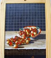 Une coupelle chinoise remplie de cerises burlat.