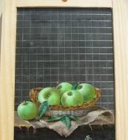 Panier de pommes Granny Smith sur un morceau de grosse toile bise.. So Rémy