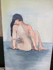 Femme nue assise.
