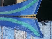 Reflet bateau pêche vert.