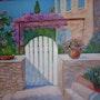 Joli portillon en bois blanc d'une entrée sur jardin. Salsera