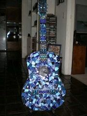 Elvis guitar. Joy Helm Riley