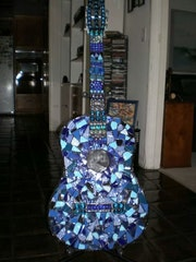 Elvis guitar. Joy Helm Riley