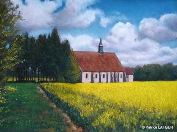Church Montliard and rapeseed field. Patrice Latger Patrice Latger