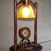 Kupferlampe mit Uhr. G P Kafka