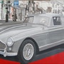 Aston Martin grise à l'opéra.
