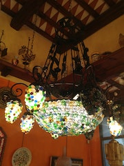 Handmade glass lamps shaped like bunches of grapes.