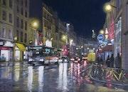 Rue du faubourg Saint-Antoine la nuit sous la pluie.