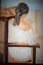 La femme assise vue de dos..