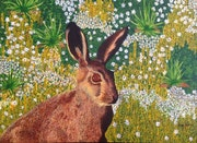 Hare on spring flowers.