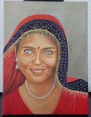 La femme indienne en rouge.