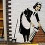 Street Cleaning Lady. Banksy