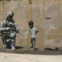 Military and child with flower. Banksy