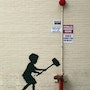Kid with hammer. Banksy
