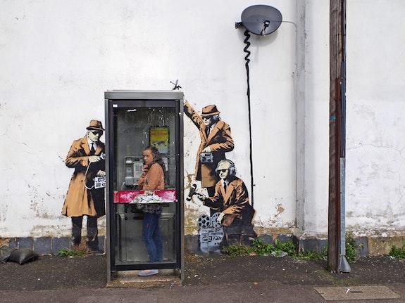 Tapped Phone Box.  Banksy