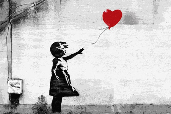 Girl with a balloon by Banksy.  Banksy