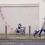 Little boy with flags. Banksy