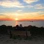 Deux Amoureux devant un coucher de soleil. Didier Collignon