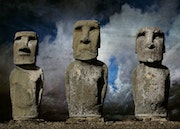 Three Moai statues on a stone platform on the Easter Island..