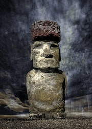 A Moai statue with hat (Pukao) on the Easter Island.. Rainer Mueller Hilmer