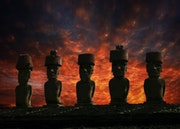 Five Moai statues with hats (Pukao) on the Ahu platform Anakena.. Rainer Mueller Hilmer