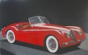 Jaguar xk120 rouge sur noir.