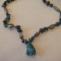 Collier artisanal de turquoise et lapis lazuli naturels avec des ornements argen. Jigée