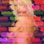 Naked woman inlaid on a brick wall. Jeanradium
