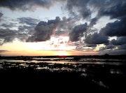 Coucher de soleil sur la baie. Jean-Pierre Wojcik