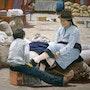 Shoeshine boy in the market. Ivan Jones