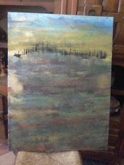 Paysage metallique sur une mer embrumée.