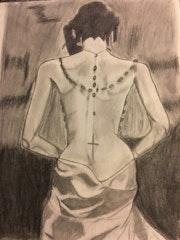La mujer con el rosario.