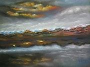 Coucher de soleil sur montagne et lac écossais.