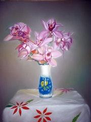 Jarrón con orquídeas.
