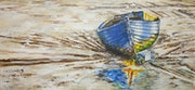 Blue Boat beached in mudflats.