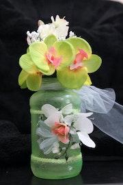 Beautiful flowers in Beautiful Mason Jars. Patti Kluesner