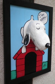 Snoopy on his doghouse. Jean De La Boulza