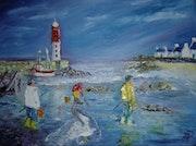 Pêche à pied dans un petit port breton.