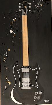 La Guitare en or et noir…. Claude Raspaldo