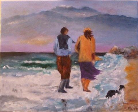 Un couple promenant leur chien sur la plage par une journée très grise. Salsera Salsera