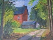Maison rouge en forêt.